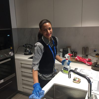 Quayclean team member cleaning kitchen area