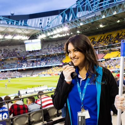 Quayclean team member talking on a radio at Etihad Stadium