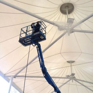 Quayclean team member pressure washing metal beam in gazebo