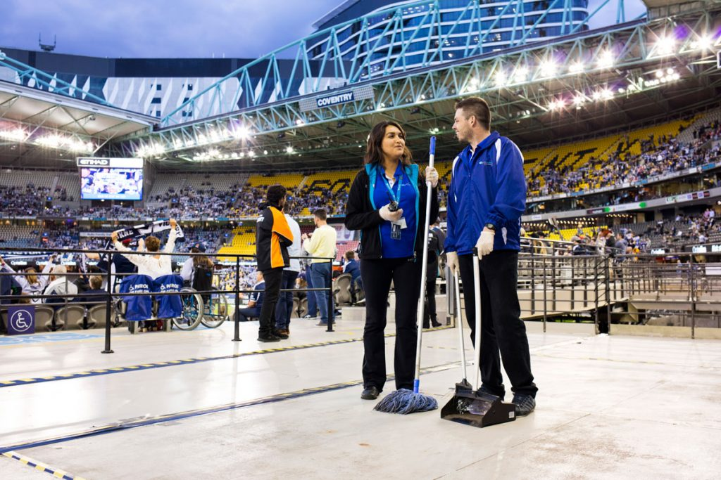 Quayclean team members discuss work inside Etihad Stadium