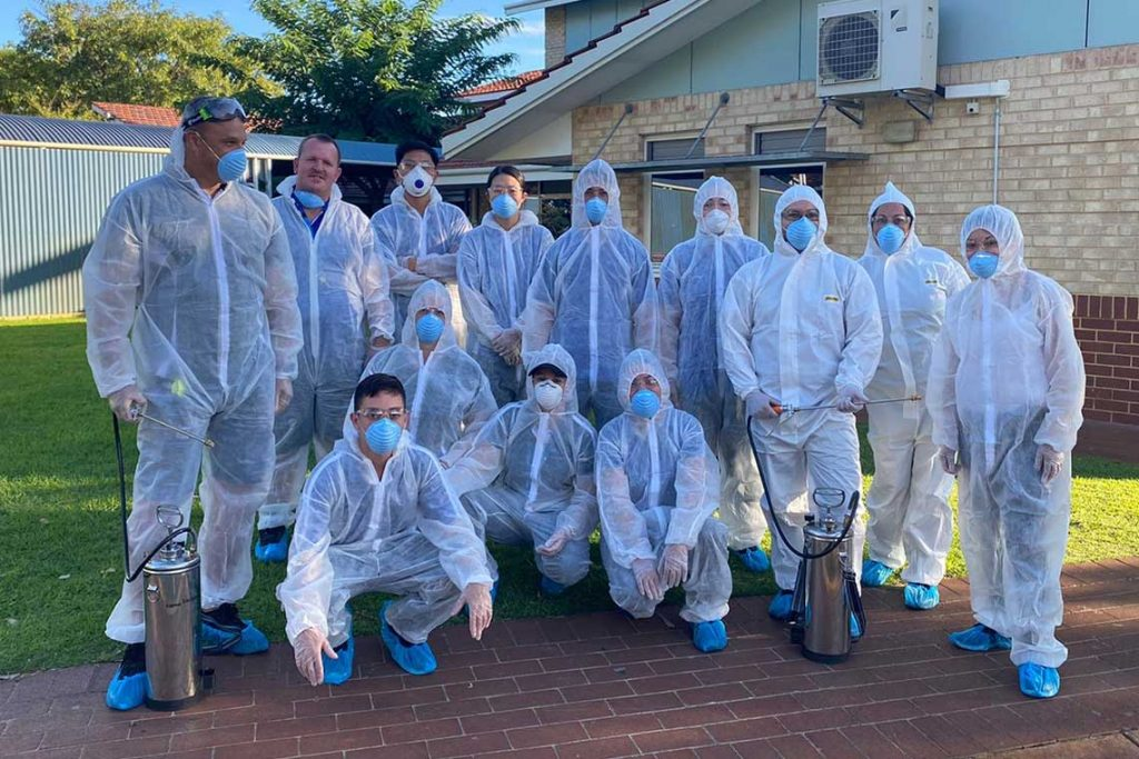 Quayclean team members wearing COVID-19 (coronavirus) Personal Protective Equipment Response Kits